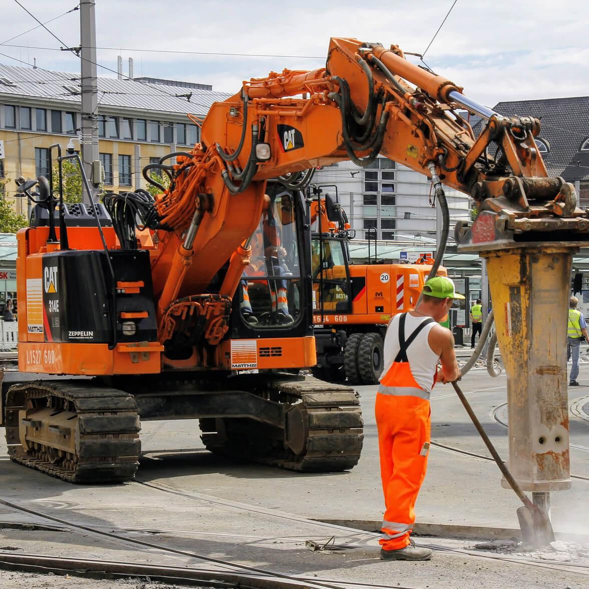 Constructors digging a road